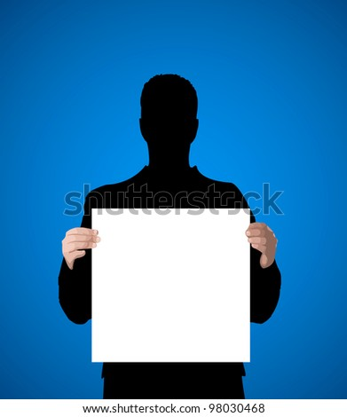 silhouette of a man holding a white sheet of paper for text - stock photo
