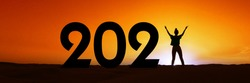 2021, silhouette of a woman standing in the sunset, women empowerment, feminist new year holiday panoramic web banner