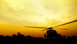 silhouette of military helicopters.