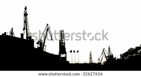 Silhouettes of Portal Cranes in a Harbor