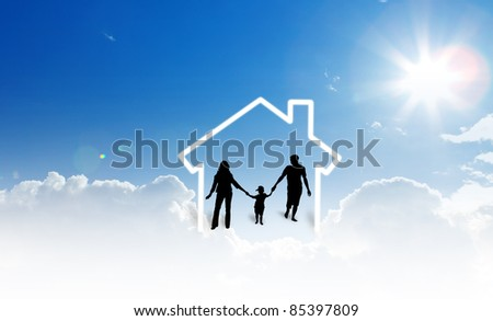 silhouettes of the family and house on blue sky
