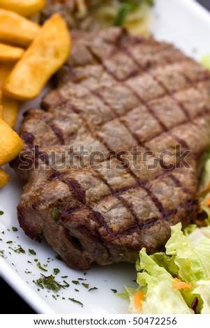 Sirloin steak with chips ,mushrooms,salad