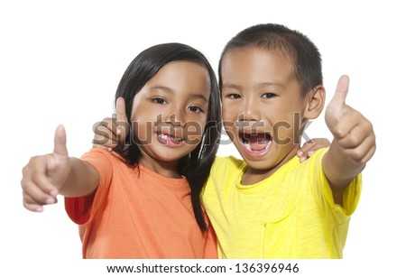 Sister Hugging Little Brother showing ok sign