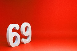 69 ( Sixty nine ) Isolated red Background with Copy Space - Number 69% Percentage or Promotion - Discount or anniversary concept