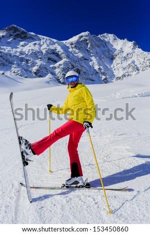 Skiing, skier, winter sport, winter fun - woman has fun on ski
