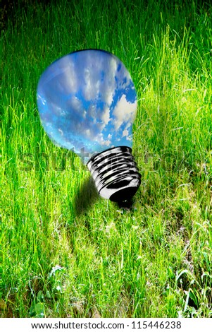 sky lightbulb on grass representing the quest for clean energy