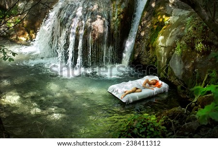 Sleeping woman in deep forest with waterfall on back