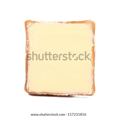 Slice of wheaten bread spreaded with butter