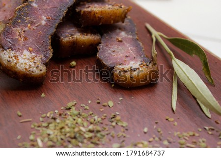 sliced biltong on chopping board with spice Stock photo ©
