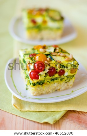 slices of vegetable gratin(quiche) with zucchini,tomato cherry and rice