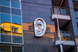 2018 Slovakia, Bratislava. Ear sculpture on the wall of the house.Modern sculpture.