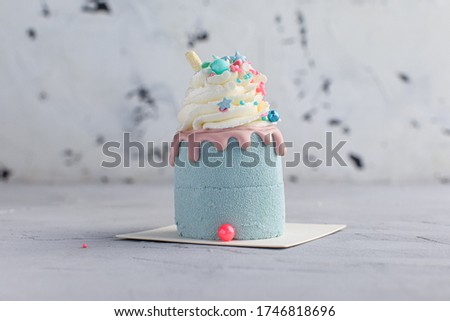 small cake on a gray background home confectionery with delivery
