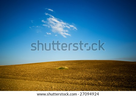 small hill with blue sky and white cloud