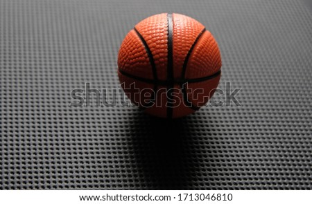 Small toy basketball ball isolated on black background Stok fotoğraf ©