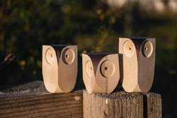 3 small wooden owl toys. different sizes. family concept