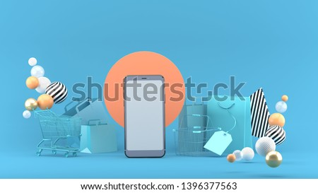 Smartphone to enter content surrounded by shopping bags, shopping carts on a blue background.-3d rendering.