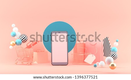 Smartphone to enter content surrounded by shopping bags, shopping carts on a pink background.-3d rendering.