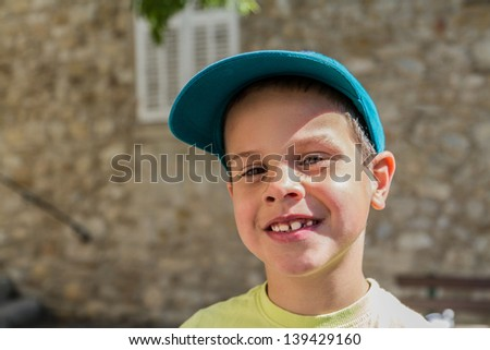 Smiling 7 years old boy in a ball cap