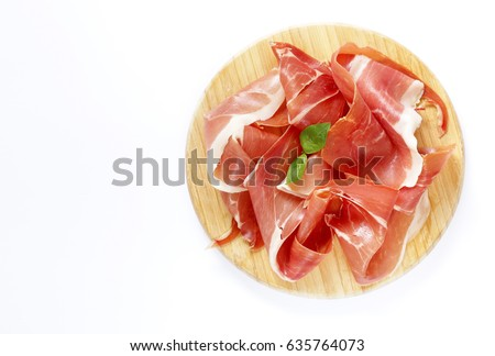 Smoked Parma ham on a wooden board Stock photo ©