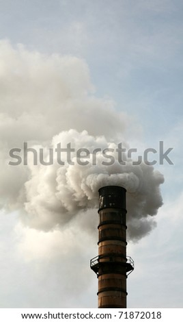 Smokestack Polluting the Air causing GLOBAL WARMING with CO2 Gas - stock photo