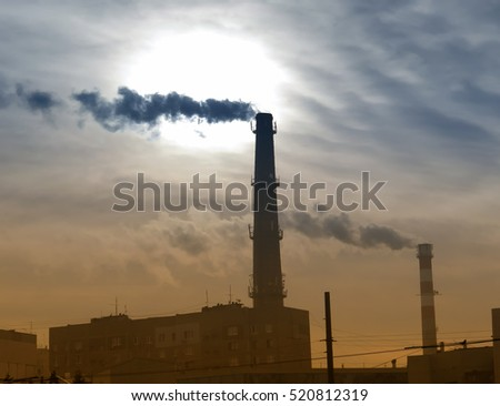 smoking chimney at sunset on...