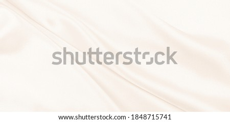 Photo of   Smooth elegant golden silk or satin luxury cloth texture can use as wedding background. Luxurious background design. In Sepia toned. Retro style