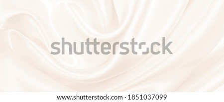 Smooth elegant golden silk or satin luxury cloth texture can use as wedding background. Luxurious background design. In Sepia toned. Retro style ストックフォト ©