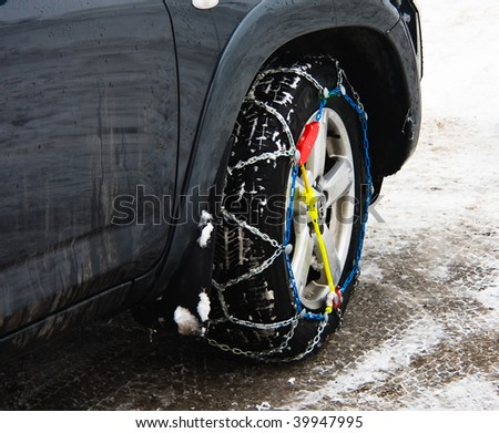 Snow chains on vehicle