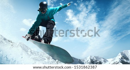 Snowboarder in action. Extreme winter sports. #1531862387