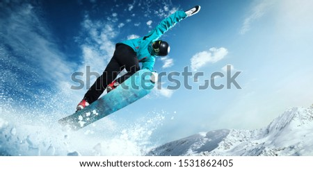 Snowboarder in action. Extreme winter sports. #1531862405