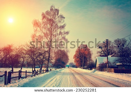 snowy rural landscape with...