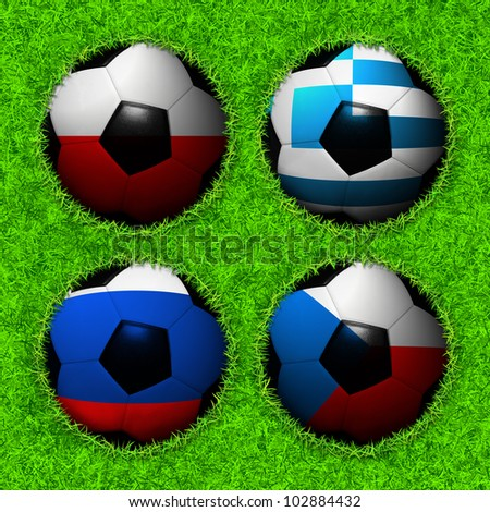 4 Soccer balls with flag pattern on the grass, Group A