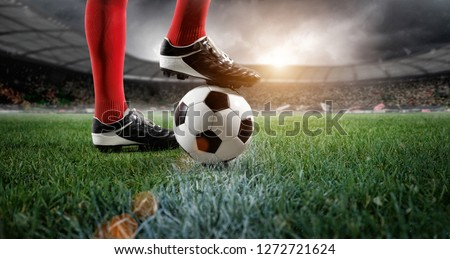 Soccer player in stadium (composition and stadium is the imaginary)