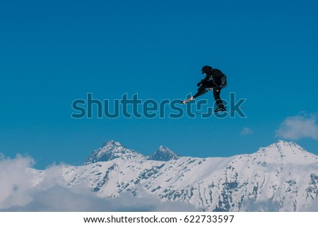 2017 04 Sochi, Russia, Festival NewStarCamp: skier jumps from a high springboard #622733597