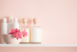 Soft light bathroom decor for advertising, design, cover, set of cosmetic bottles, orchid in a vase. Natural color. mock up