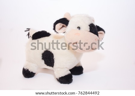 Soft toy cow on white background
