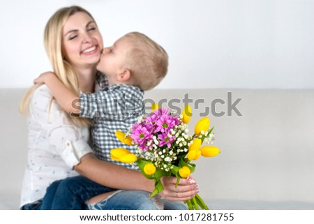 Son gives his beloved mother a beautiful bouquet of tulips.The concept of the celebration,women's day. #1017281755