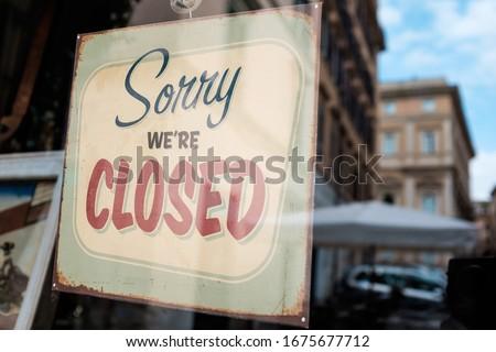 """Sorry we're closed"" door sign board on shop window,abandoned closed shut down cafe restaurant business,Coronavirus COVID-19 virus disease global pandemic crisis,isolation quarantine lockdown concept"