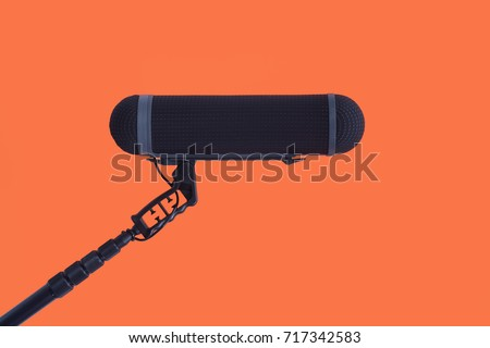 Sound recorder microphone, boom mic on red background