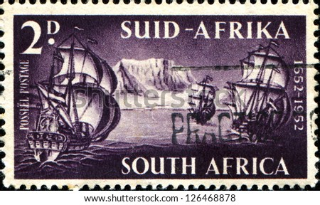 SOUTH AFRICA - CIRCA 1952: A stamp printed in South Africa shows arrival of Danish colonizers at Cape of Good Hope 1652, 300 anniversarycirca 1952