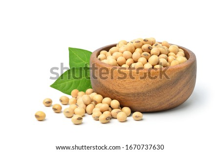 Soybean seeds in wooden bowl with green leaves isolated on white background. Stock photo ©