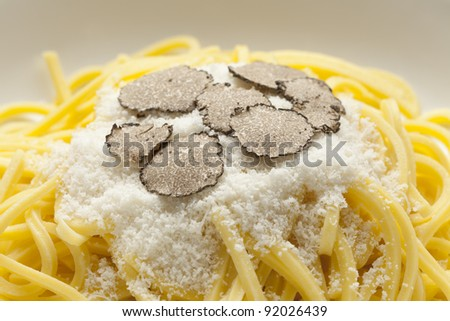Spaghetti with black winter truffle and Parmesan cheese close up