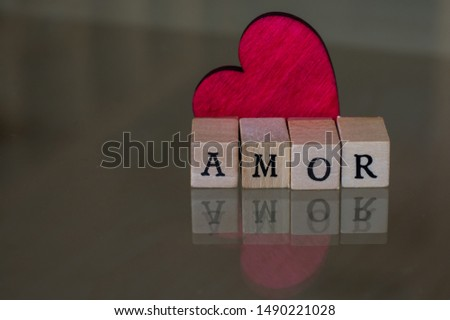Special image for Valentine's Day with a red heart and the word AMOR, which means love #1490221028
