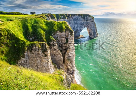 Spectacular natural cliffs Aval of Etretat and beautiful famous coastline, Normandy, France, Europe