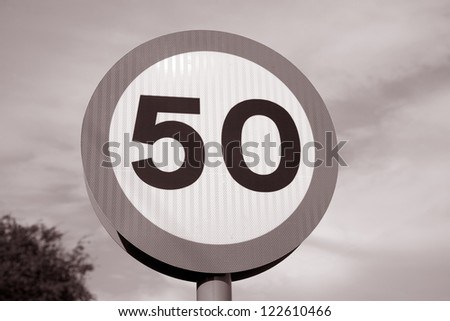 50 Speed Sign on Blue Sky Background - stock photo