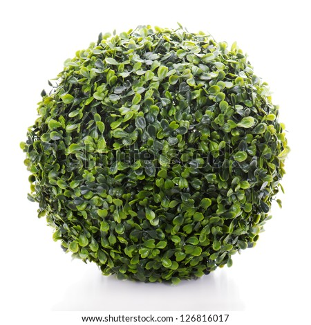 sphere from green artificial grass isolated on white background