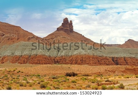 spire in the desert near goblin state park in  central utah