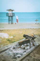 Spit boat with bonfire and the sea in the background