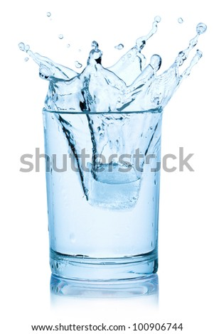 Splash from ice cube in a glass of water, isolated on the white background, clipping path included. - stock photo