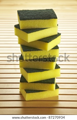 8 sponges to clean dishes stacked in the kitchen